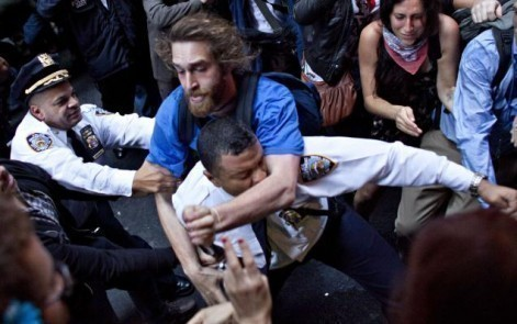 white kids assault black police officer Violence at Occupy Wall Street